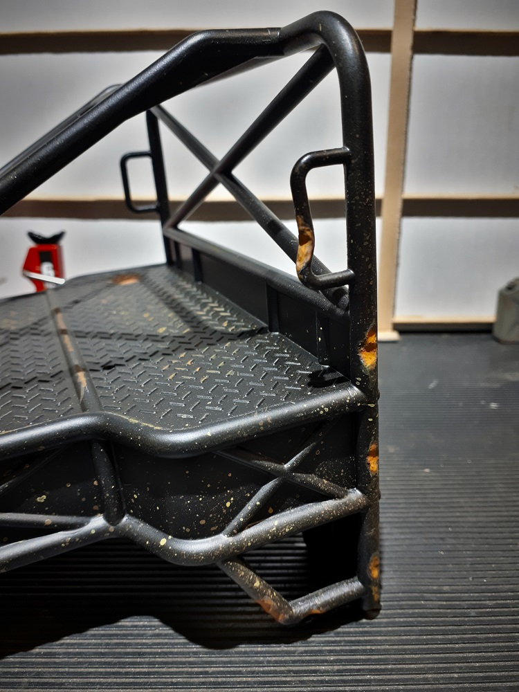 Rear tray-cage damage and weathering detail.jpg